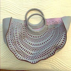 Henri Bendel Perforated semi circle tote